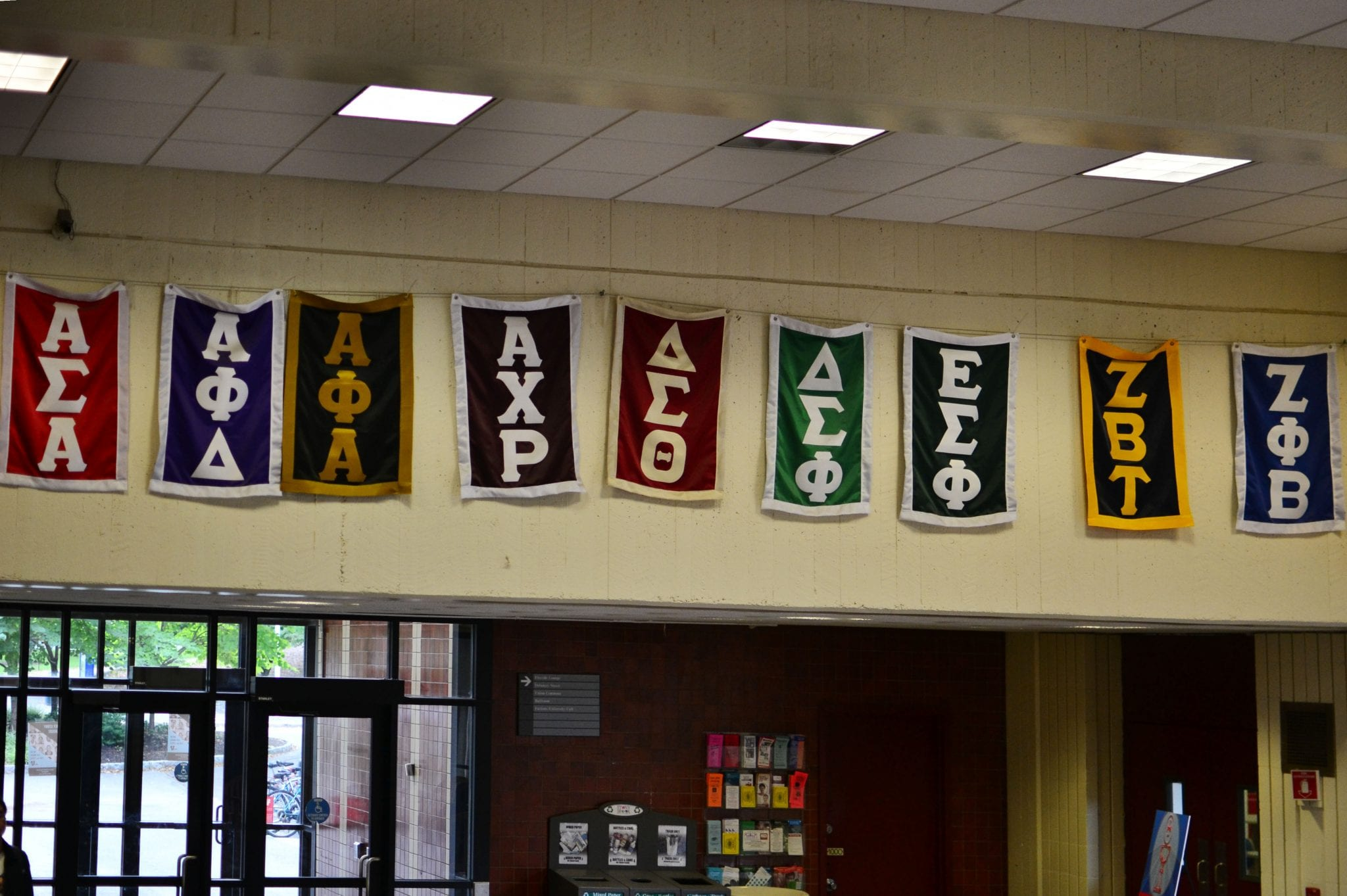 Greek organization banners are displayed in the lobby of the Stony Brook student union. (Nina Lin / The Statesman)