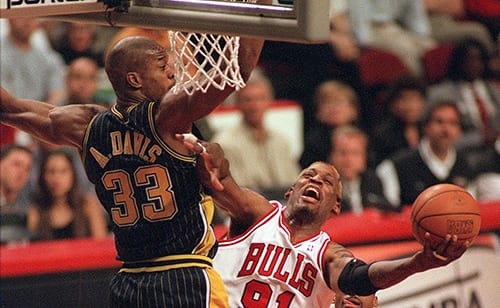 Dennis Rodman (C) tries to keep the ball away from Indiana Pacers Antonio Davis (L) during 2nd quarter play in Chicago, IL., Sunday.  Chicago won game 1 of the Eastern Conference final 85-79.