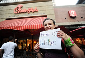 A protester offers free glitter outside a Chick-fil-A restaurant in Crystal City, Virginia, Friday, August 3, 2012.