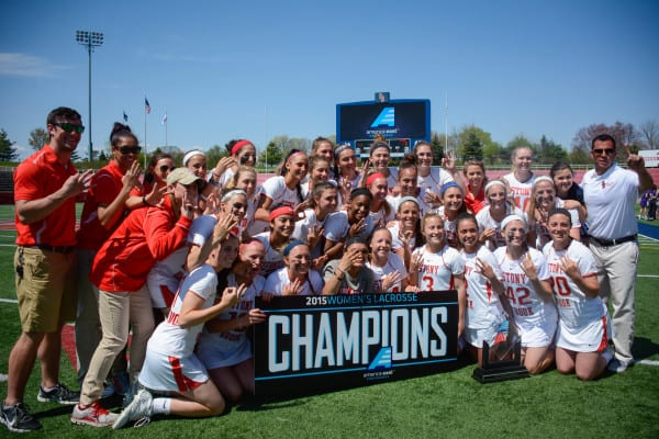 The Stony Brook Women's Lacrosse team celebrating their third consecutive American East Conference Championship in the 2015 season. HEATHER KHALIFA / THE STATESMAN