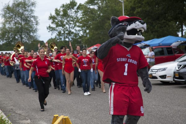 "Wolfie leading the Spirit of Stony Brook marching band from ""The Lot"" to Kenneth P. LaValle stadium for the football game against Central Connecticut. GISELLE MIRANDA/THE STATESMAN"