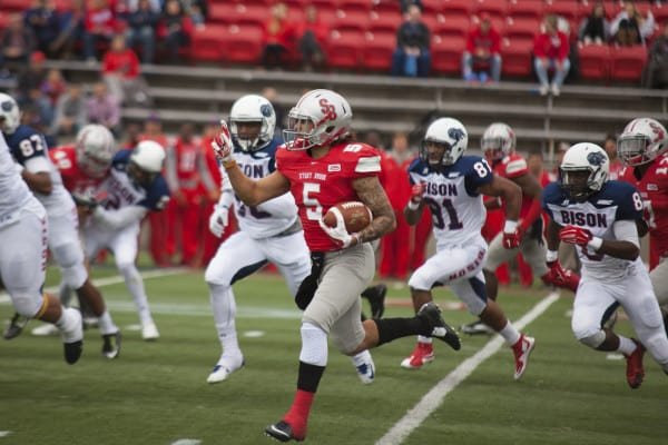 Stony Brook wide reciever Donavin Washington (No.5, above) rushes after a punt served by Howard University during Saturday's non-conference football game. CHRISTOPHER CAMERON/THE STATESMAN